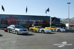 Chevrolet Corvette pace cars in front of the Chevrolet transporter
