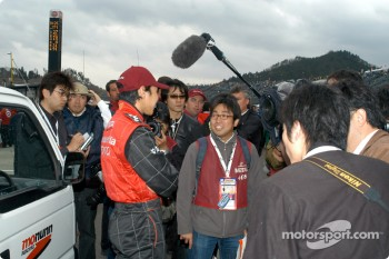 Tora Takagi talks with reporters