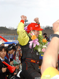 Race winner Scott Sharp celebrates
