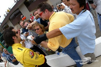 Sam Hornish Jr. interviewed by Motorsport.com's Anne Proffit and members of other media