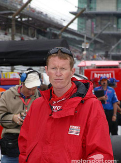 Scott Dixon watches practice