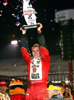Dan Wheldon celebrates victory