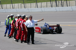 IRL safety team members give thumb up to Buddy Rice and the other drivers