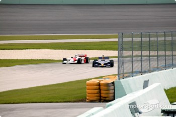 Helio Castroneves and Alex Barron
