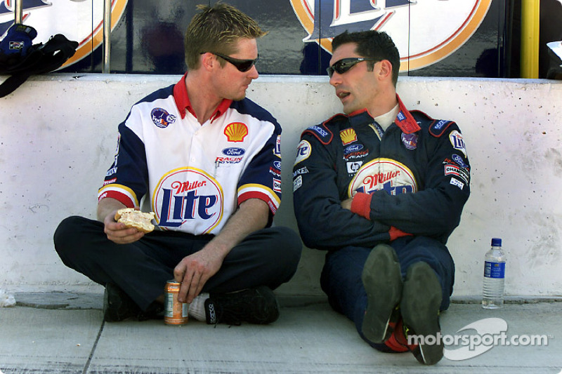 Max Papis discusses the Sunday morning delays with a member of the his crew