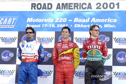 The podium: Michael Andretti, Bruno Junqueira and Adrian Fernandez