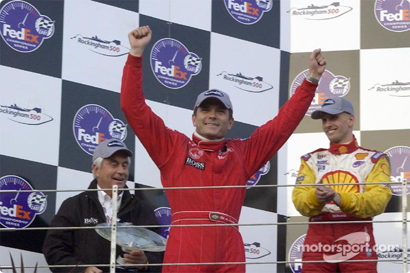 The podium: race winner Gil de Ferran, with Roger Penske and Kenny Brack