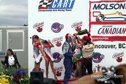 The podium: champagne for Dario Franchitti