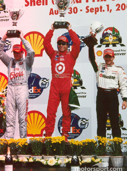 The podium: race winner Bruno Junqueira, Scott Dixon and Cristiano da Matta