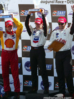 The podium: race winner and 2002 CART Champion Cristiano da Matta with Christian Fittipaldi and Jimmy Vasser