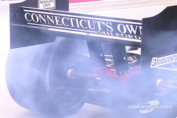Tires smoke on Sébastien Bourdais' car