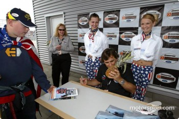 A fan presents Alex Zanardi with his trademark pineapple