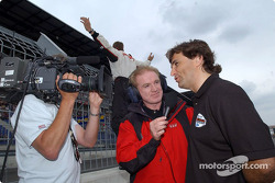 Derek Daly interviews Alex Zanardi while Sébastien Bourdais gets fans to cheer on Alex