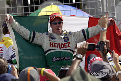 Race winner Mario Dominguez celebrates