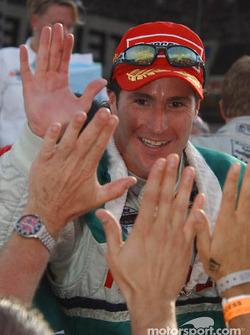Mario Dominguez celebrates podium finish