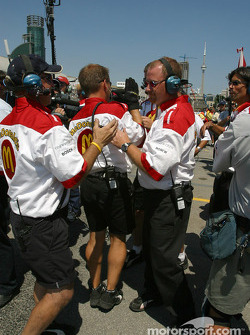 Newman-Haas team members celebrates pole position