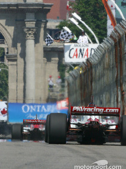 Checkered flag for Sébastien Bourdais and Jimmy Vasser
