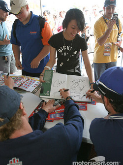 Autograph session: Mario Haberfeld and Alex Tagliani sign a book