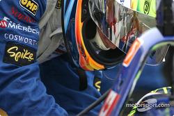 A Rocketsports Racing crew member straps Alex Tagliani in