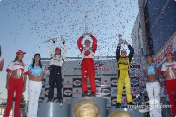 Podium: race winner and 2004 Champ Car World Series champion Sbastien Bourdais with Bruno Junqueira and A.J. Allmendinger