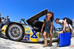 A young fan really liked the Rolex Daytona Protoype GrandAm car during the grid walk