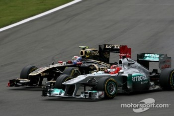 Michael Schumacher, Mercedes GP and Vitaly Petrov, Lotus Renalut F1 Team