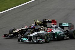Michael Schumacher, Mercedes GP and Vitaly Petrov, Lotus Renalut F1 Team