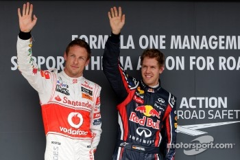 Jenson Button, McLaren Mercedes, Sebastian Vettel, Red Bull Racing