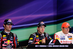 Press conference: race winner Sebastian Vettel, Red Bull Racing, with second place Mark Webber, Red Bull Racing, and third place Jenson Button, McLaren Mercedes