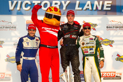 Podium: race winner Will Power, Team Penske, second place Oriol Servia, Newman/Haas Racing, third place Tony Kanaan, KV Racing Technology-Lotus