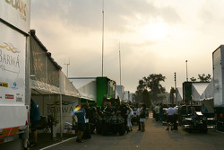 Teams prepare for the session in the paddock at sun rise