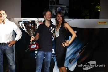 2011 GP2 Series Champion Romain Grosjean collects the GP2 Champion Trophy