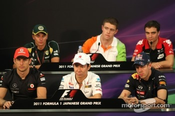 Jenson Button, McLaren Mercedes, Kamui Kobayashi, Sauber F1 Team and Sebastian Vettel, Red Bull Racing