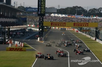 Start of the race, Sebastian Vettel, Red Bull Racing and Jenson Button, McLaren Mercedes