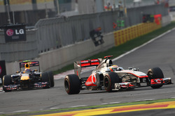 Lewis Hamilton, McLaren Mercedes leads Mark Webber, Red Bull Racing