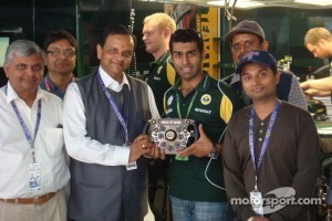 Karun shows Manoj Gaur, Executive Chairman, Jaypee Group, and family around the Team Lotus pits