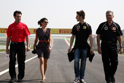 Romain Grosjean, , Lotus Renault GP and his girlfriend Marion Joles, walks the track