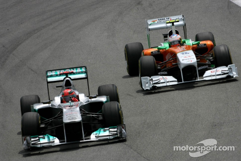 Michael Schumacher, Mercedes GP and Paul di Resta, Force India F1 Team