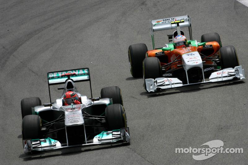Michael Schumacher, Mercedes GP and Paul di Resta, Force India F1 Team