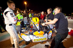 Jan Heylen and his team work on his kart on the starting grid