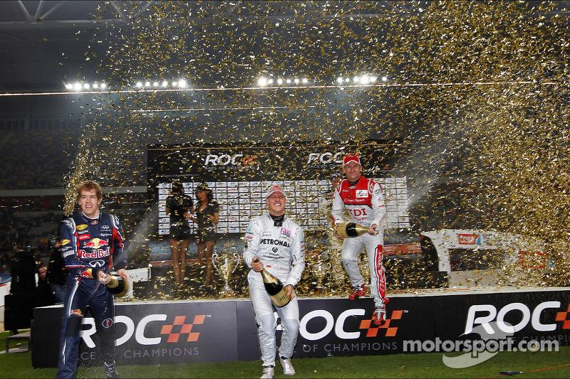 Podium: Team Germany's Sebastian Vettel and Michael Schumacher, second place, Team Nordic, Tom Kristensen and Juho Hanninen