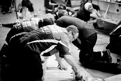 Stewart-Haas Racing Chevrolet team members work hard to repair the car of Tony Stewart