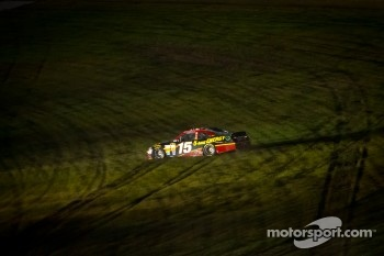 Clint Bowyer, Michael Waltrip Racing Toyota in the grass