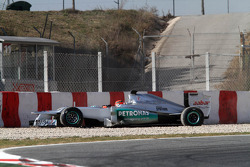 Michael Schumacher, Mercedes GP in the gravel trap at turn 5 the hairpin