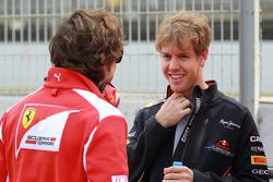 Fernando Alonso, Scuderia Ferrari with Sebastian Vettel, Red Bull Racing