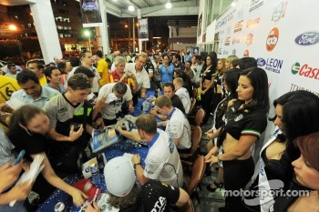 The Ford World Rally Team drivers sign autographs