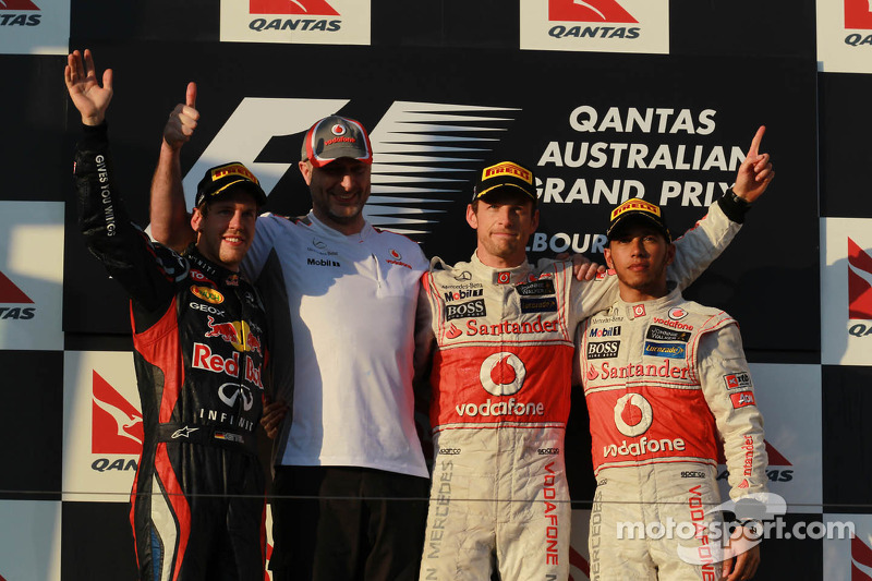 2nd place Sebastian Vettel, Red Bull Racing with 1st place Jenson Button, McLaren Mercedes and 3rd place Lewis Hamilton, McLaren Mercedes
