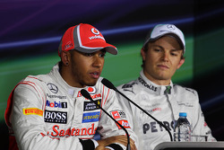 Lewis Hamilton, McLaren with pole sitter Nico Rosberg, Mercedes AMG F1 in the FIA Press Conference