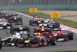Mark Webber, Red Bull Racing and Sergio Perez, Sauber at the start of the race