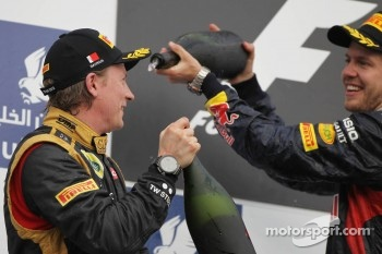 Kimi Raikkonen, Lotus F1 Team celebrates his second position on the podium with race winner Sebastian Vettel, Red Bull Racing